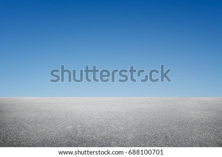 Side view asphalt road with blue sky .