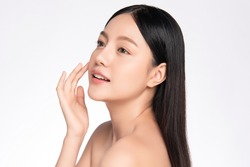 Side view Beautiful Young asian Woman with Clean Fresh Skin, on white background, Face care, Facial treatment. Cosmetology, beauty and spa. Asian women portrait
