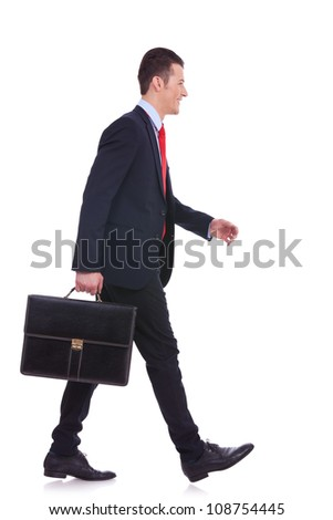 side view business man holding brief case and walking over white background