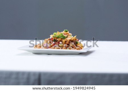 side view Chola Chana Chaat, plate of Chickpeas curry or Chola masala. Ramadan Iftari Dinner. Ramzan Meal. Specially for Eid, Diwali or. Top Refreshment for Roza Iftar. Indian street food