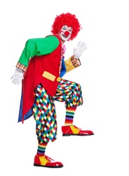 Side view full length picture of a clown imitating comic walk