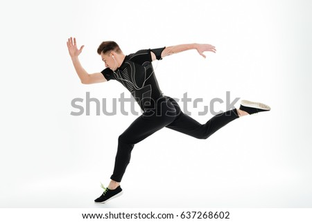 Side view full length portrait of a healthy sportsman started to run isolated over white background #637268602