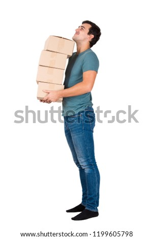 Side view full length portrait of cheerful young man carry boxes and look up isolated over white background. #1199605798