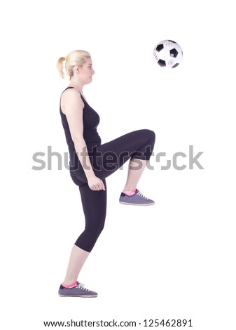 Side view image of a sporty woman playing soccer ball on a white background