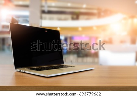 Side view laptop with blank screen on table in the room office, Online shopping concept.