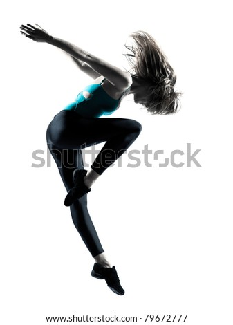 Side view of a beautiful young female dancer showing her dancing skills on white background