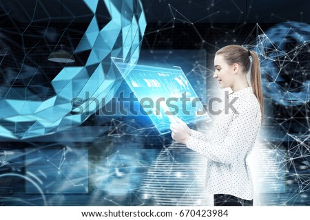 Side view of a blond businesswoman with a ponytail. She is wearing a white blouse and a black skirt and looking at a tablet computer she is holding. Virtual screen, spheres. Toned image #670423984