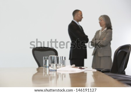 Side view of a business couple in discussion at conference room
