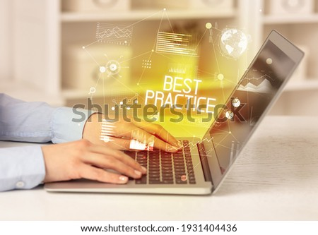 Side view of a business person working on laptop with BEST PRACTICE inscription, modern business concept Foto stock ©