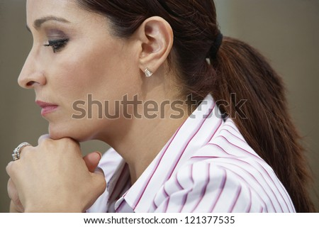 Side view of a business woman day dreaming