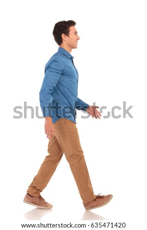 side view of a confident casual man walking forward on white background
