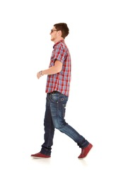 side view of a fashion man walking forward over white