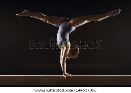 Young girl doing the splits stretching Images and Stock Photos