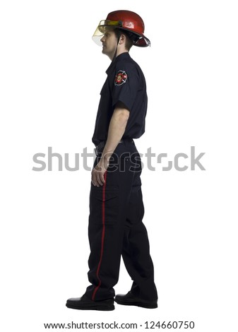 Side view of a fireman over the white surface