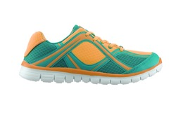 Side view of a green and gold training shoe on white background