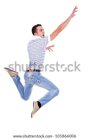 side view of a jumping young casual man on white background