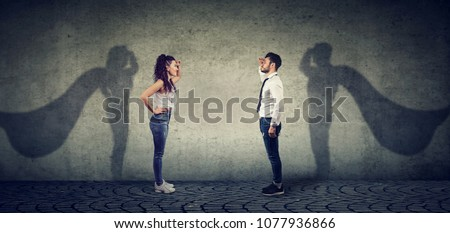 Side view of a man and woman imagining to be a super hero looking aspired.  ストックフォト ©