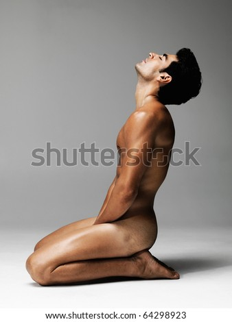 stock photo : Side view of a nude young man posing against grey background