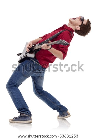 side view of a passionate guitarist playing his electric guitar on white background