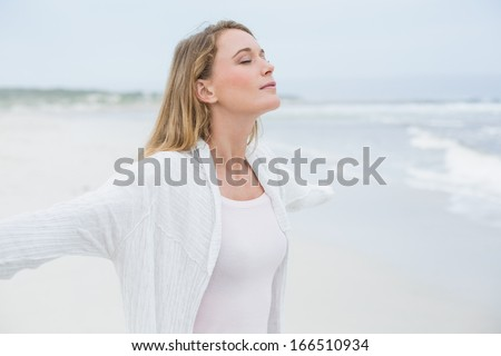 Side view of a peaceful casual young woman with eyes closed at the beach - Shutterstock ID 166510934