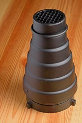 Side view of a photographic cone with a grid attachment close up