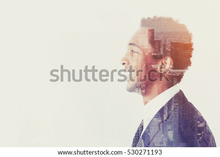 Side view of a positive African American businessman smiling and looking forward. There is a city view in the foreground. Mock up. Toned image. Double exposure
