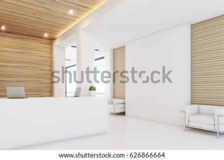 Side view of a reception desk standing in an office lobby with light wooden wall elements and white armchairs. 3d rendering, mock up