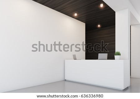 Side view of a reception desk standing in an office with dark wooden wall elements. 3d rendering, mock up