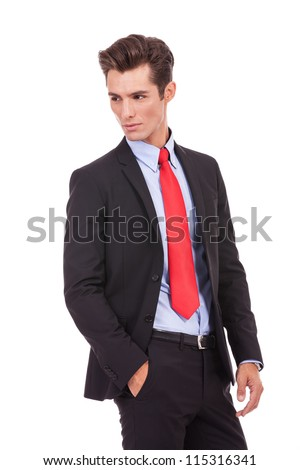 side view of a serious fashion business man looking at his back