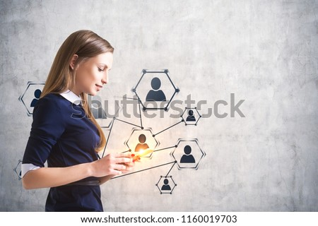 Side view of a smiling calm businesswoman looking at her smartphone screen. Human resources network icons over concrete wall. Toned image mock up