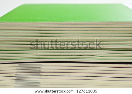 Side view of a stack  books
