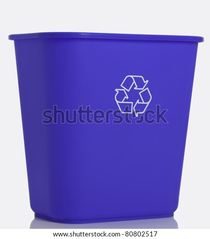 Side view of a tall blue recycling bin isolated on white background. - stock photo
