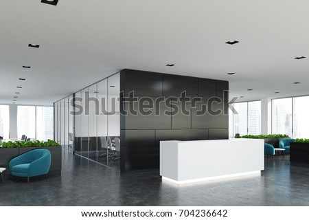 Side view of a white reception desk standing in an open space office environment with a black wall, rows of computer tables and loft windows. 3d rendering mock up