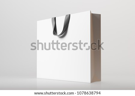 Side view of a white shopping bag on a gray background. 3d rendering mock up #1078638794