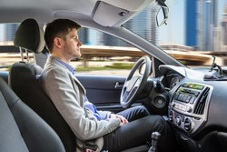 Side View Of A Young Man Sitting Inside Autonomous Car
