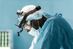 side view of african american surgeon in operating room