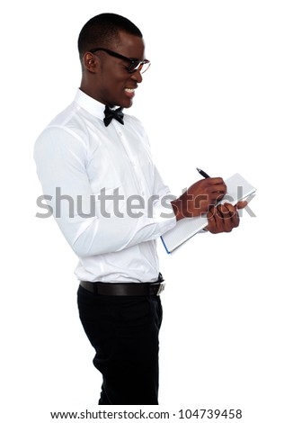 Side view of african employee writing on clipboard isolated against white background