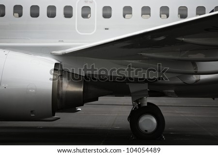 Side view of aircraft fuselage and engine