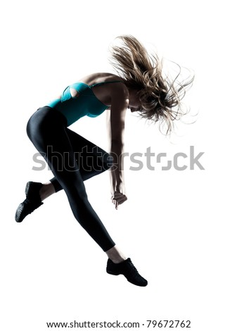 Side view of an energetic female doing aerobics isolated on white background