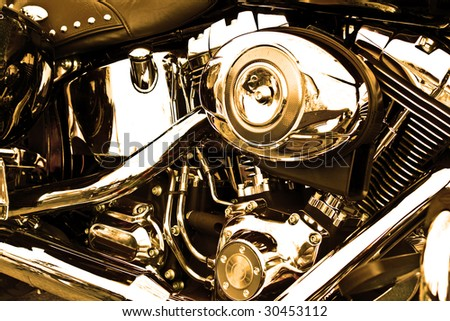 Side view of an engine of motorcycle in sepia.