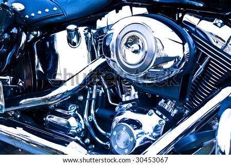 Side view of an engine of motorcycle, with blue tint.