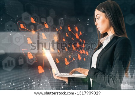 Side view of attractive young european adult using laptop on abstract blurry interior background with digital interface. Innovation and touchscreen concept  #1317909029
