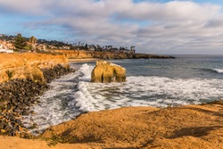 Side view of Bird Rock and rocky cliffs at Sunset Cliffs in San Diego, California.