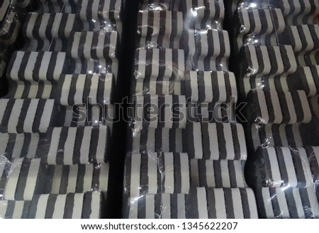 side view of black and grey rubber matting creating a graphic monochromatic pattern #1345622207