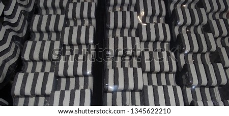 side view of black and grey rubber matting creating a graphic monochromatic pattern #1345622210
