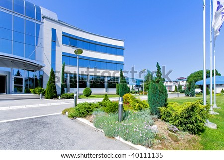 Side view of blue glass office building