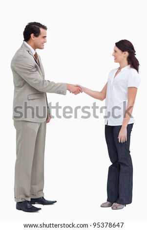 Side view of business people shaking hands against a white background