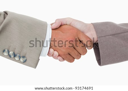 Side view of business peoples hands shaking against a white background
