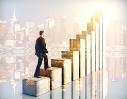 Side view of businessman climbing chart bar ladder on city background. Double exposure. Success concept