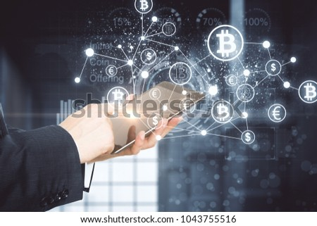 Side view of businessman hands using tablet with creative blockchain hologram. Cryptography and technology concept. Double exposure